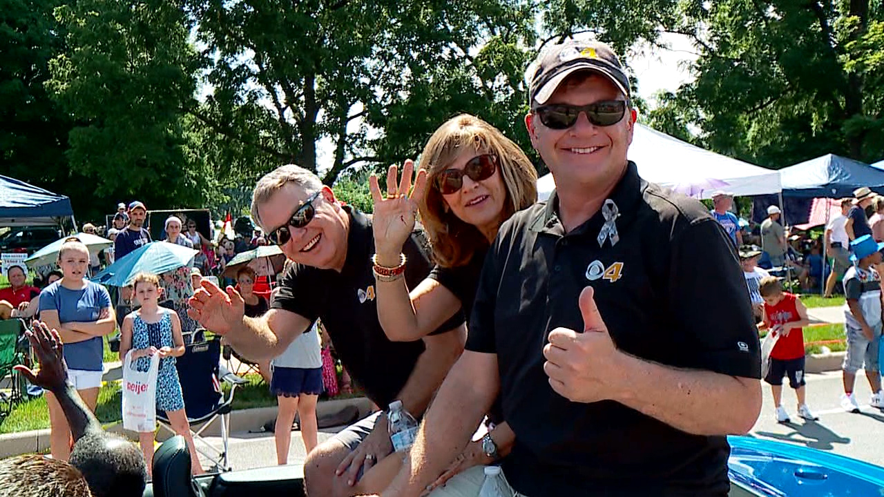 Bob Donaldson, Debby Knox and Chris Widlic from CBS4 ride in the 2019 CarmelFest Fourth of July parade