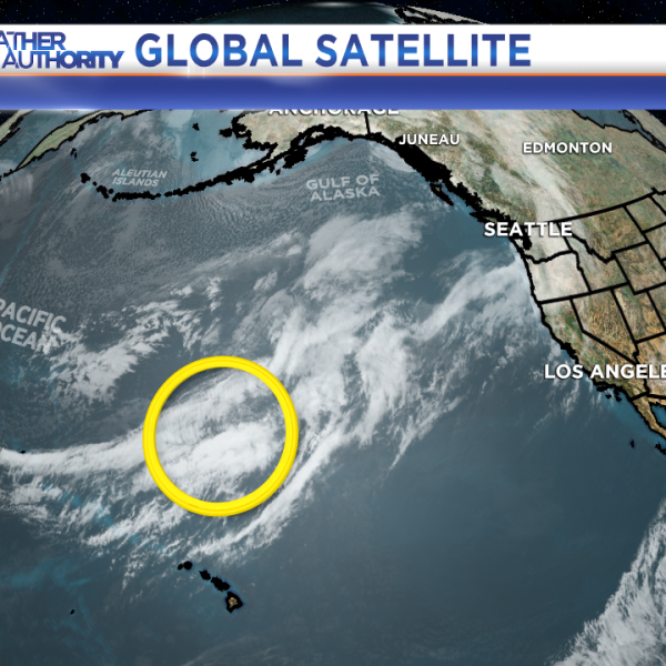 Upper-level energy is passing over the Pacific Ocean.
