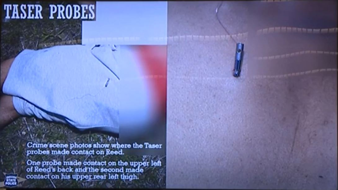 Crime scene photos show where the Taser probes made contact on Reed. One probe made contact on the upper left of Reed's back and the second made contact on his upper rear left thigh.