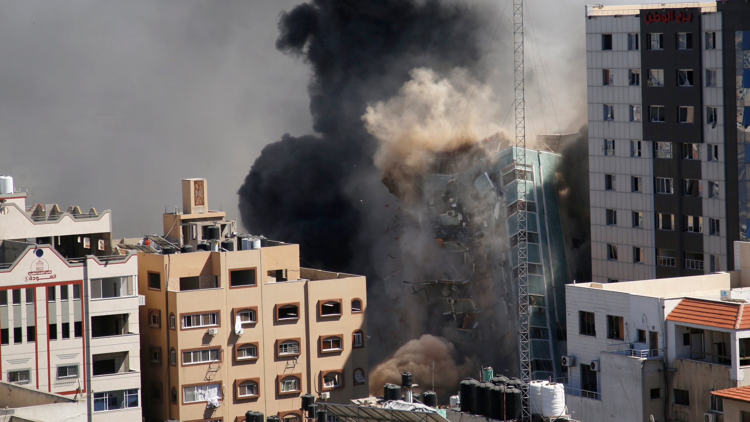 A view of a 11-story building housing AP office and other media in Gaza City is seen moments after Israeli warplanes demolished it, Saturday, May 15, 2021. The airstrike Saturday came roughly an hour after the Israeli military ordered people to evacuate the building. There was no immediate explanation for why the building was targeted. The building housed The Associated Press, Al-Jazeera and a number of offices and apartments. (AP Photo/Hatem Moussa)