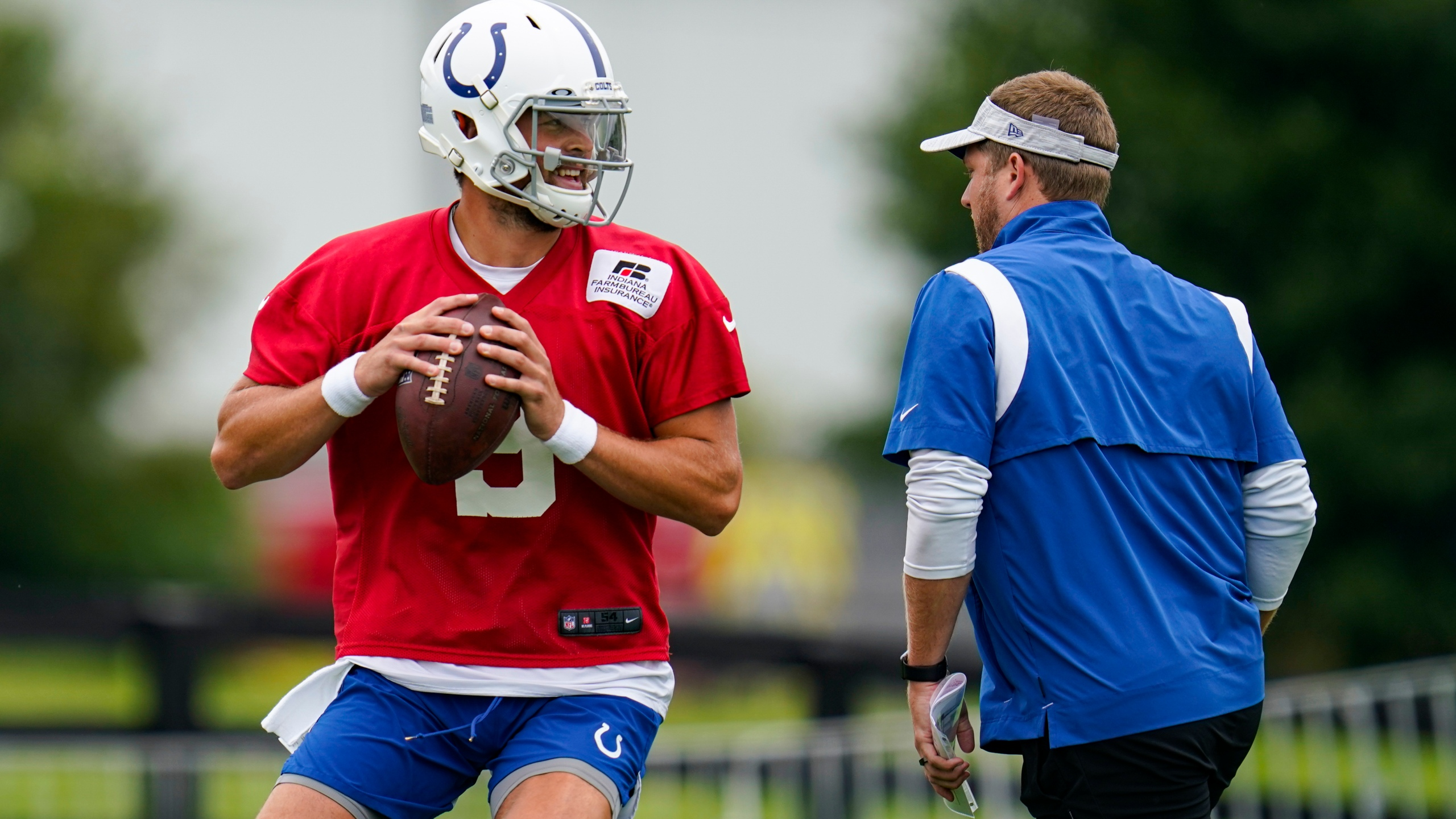 Indianapolis Colts quarterback Jacob Eason runs a drill during practice at the NFL team's football training camp in Westfield, Ind.