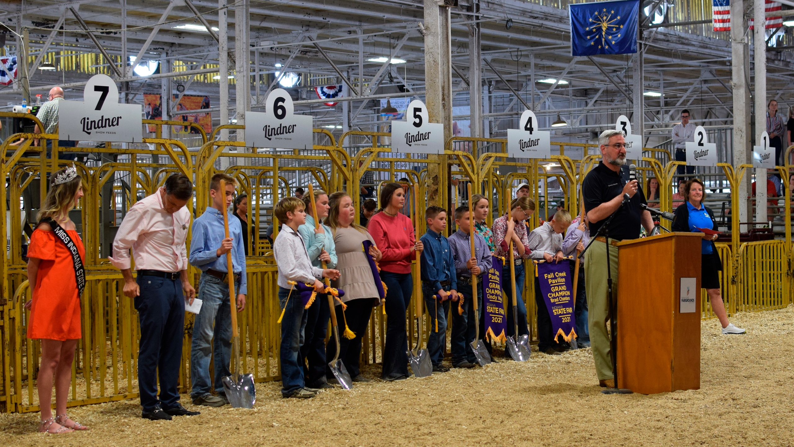 Indiana Gov. Eric Holcomb speaks at the groundbreaking for the Indiana State Fairgrounds' new Fall Creek Pavilion, which will replace the century-old Swine Barn on Friday, Aug. 6, 2021 in Indianapolis.
